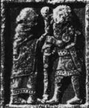 Tunic and Léine. Carving from Clonmacnois Monastery, Ireland