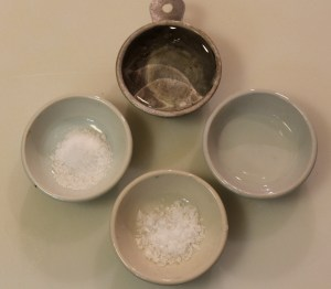 Clockwise from top: light corn syrup; almond extract; flaked sea salt, fine sea salt