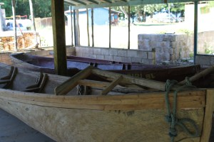 Boats in various stages of construction.