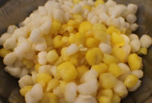 The hominy. I like to use both yellow and white. It's simply a personal preference. There's absolutely no difference in the flavor.