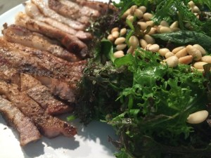 Wednesday Night's Dinner: Salad with curly mustard greens and pine nuts; pork chops.