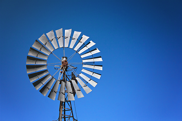 Windmill against a deep blue Australian sky