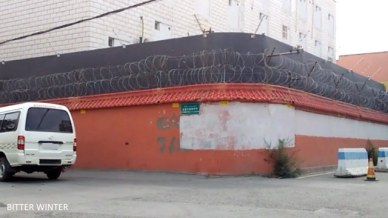 Building's outer wall with two layers of barbed wire and high definition surveillance cameras