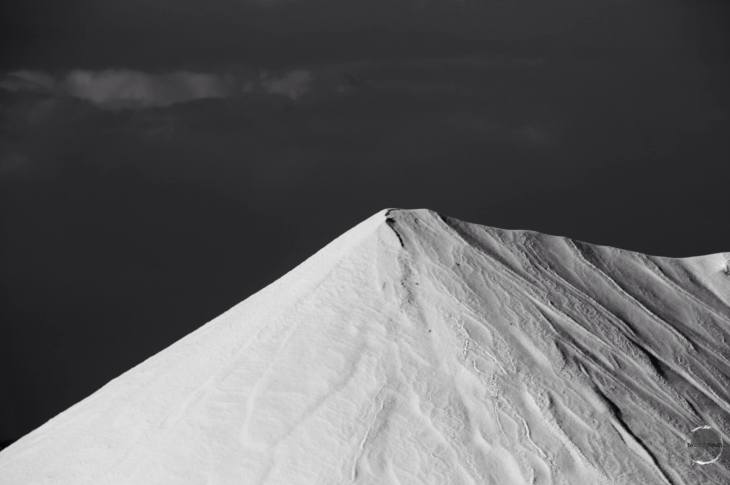The salt piles stand like white pyramids at the southern end of the island