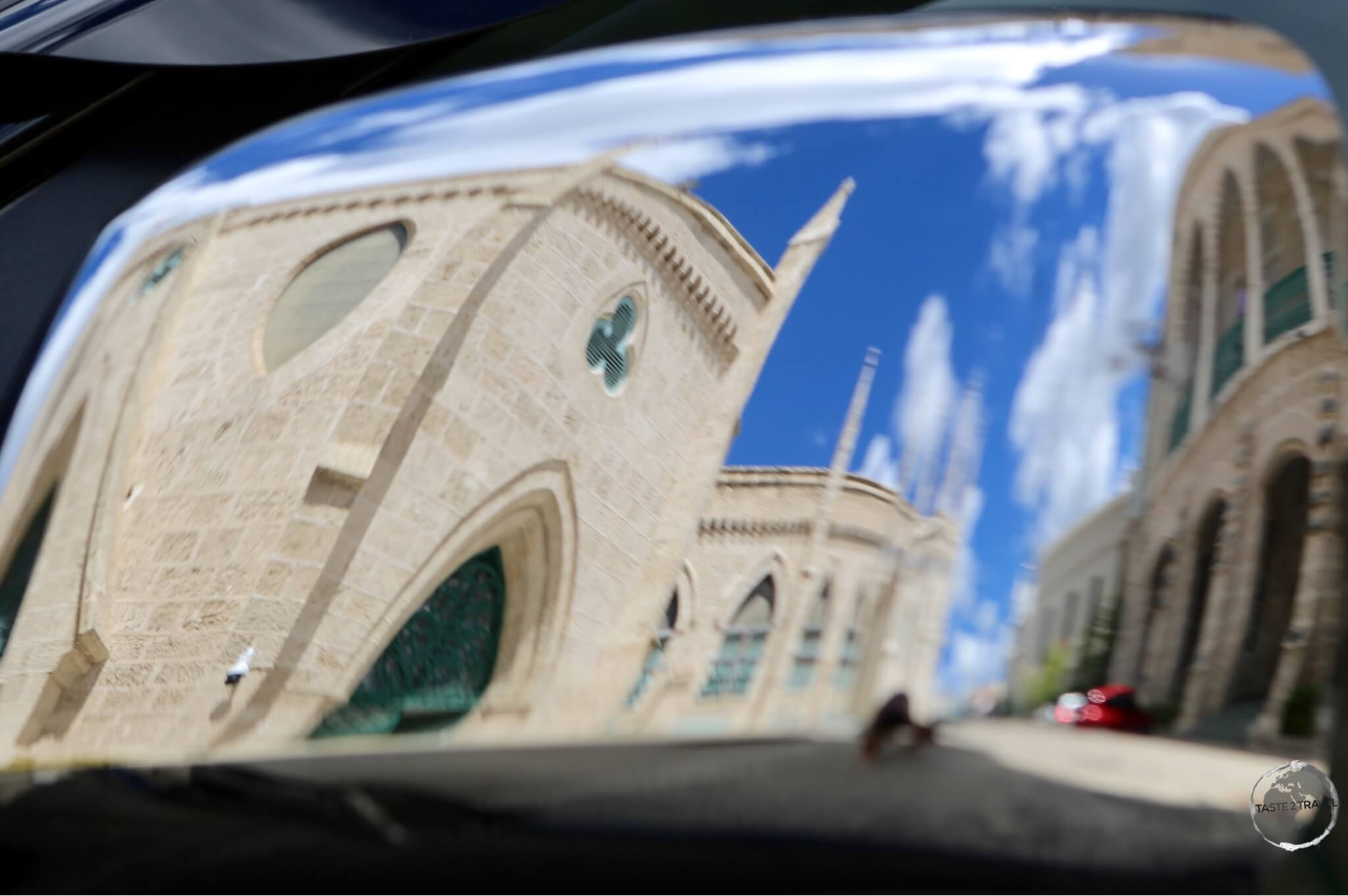 Reflection of coral-limestone buildings in Bridgetown.