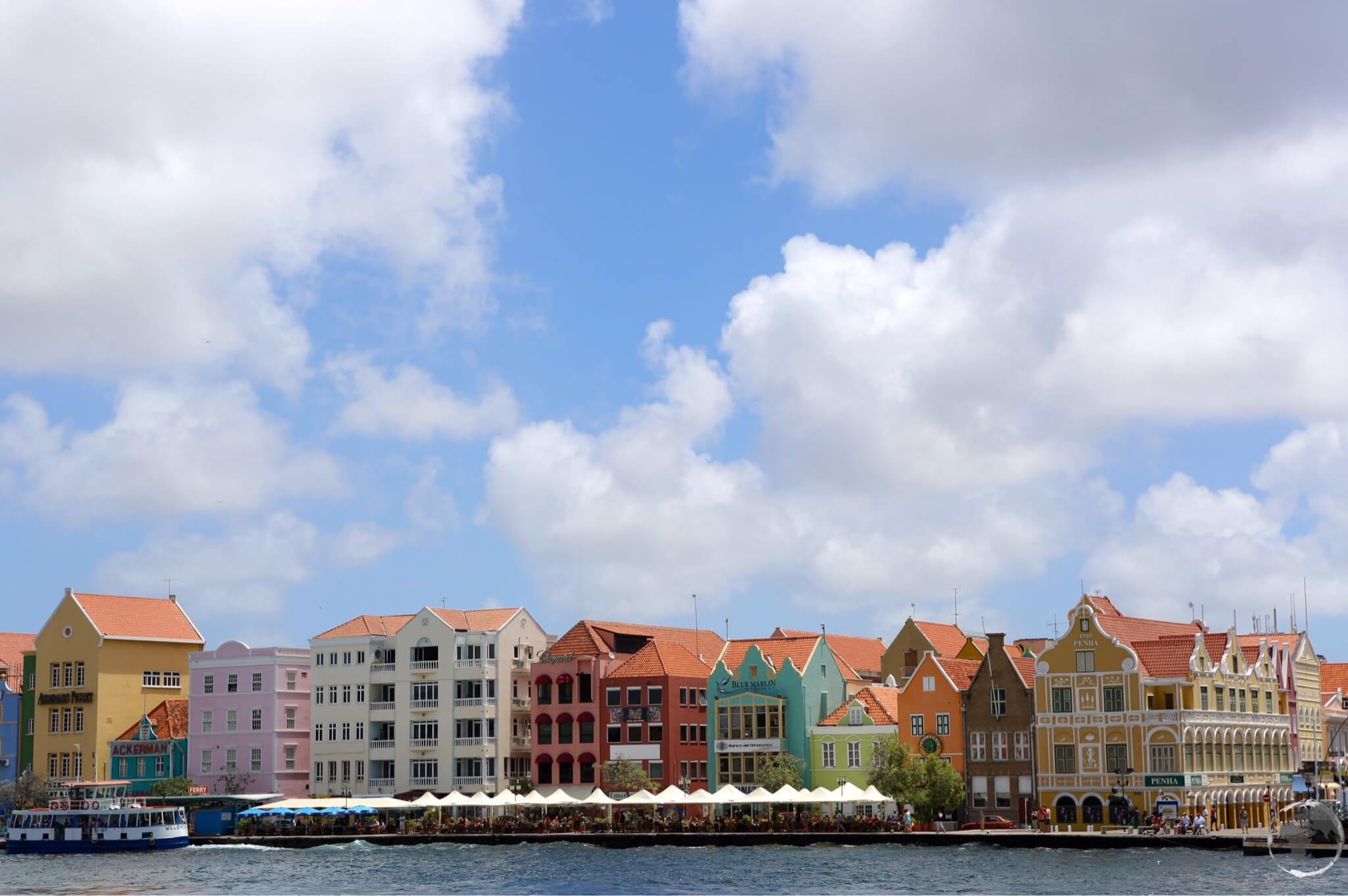 The houses which line the Handelskade form a colourful waterfront in Willemstad.