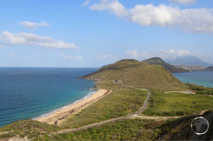 A view of the isthmus and peninsula at the southern end of St. Kitts. Nevis peak is in the distance.