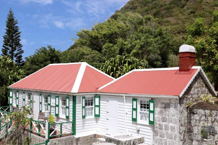 A strict building code on the island ensures all buildings are painted white, with green trim and red roofs.