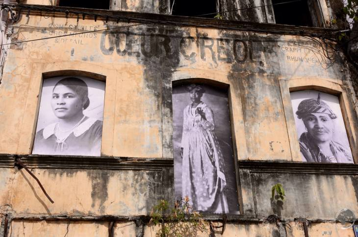 A ruined building in St. Pierre displays photos of some of the victims of the volcanic eruption which destroyed the former capital.