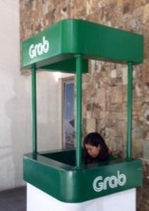 Grab Taxi counter in Manila.