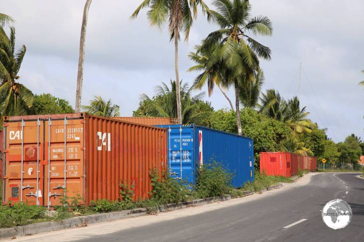 Discarded shipping containers line the streets on Betio Island. There is no real port facility so the containers are left on the roadside and are used for storage by local shop owners.