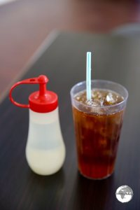 Iced Tea served with simple syrup on the side.