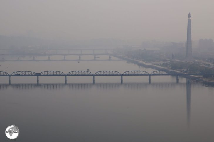 Early morning view of the Taedong River, which passes through downtown Pyongyang (Juche Tower can be seen on the right bank).