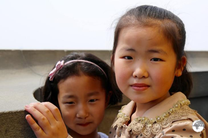 Young girls enjoying the views of Pyongyang from the top of the Juche Tower.