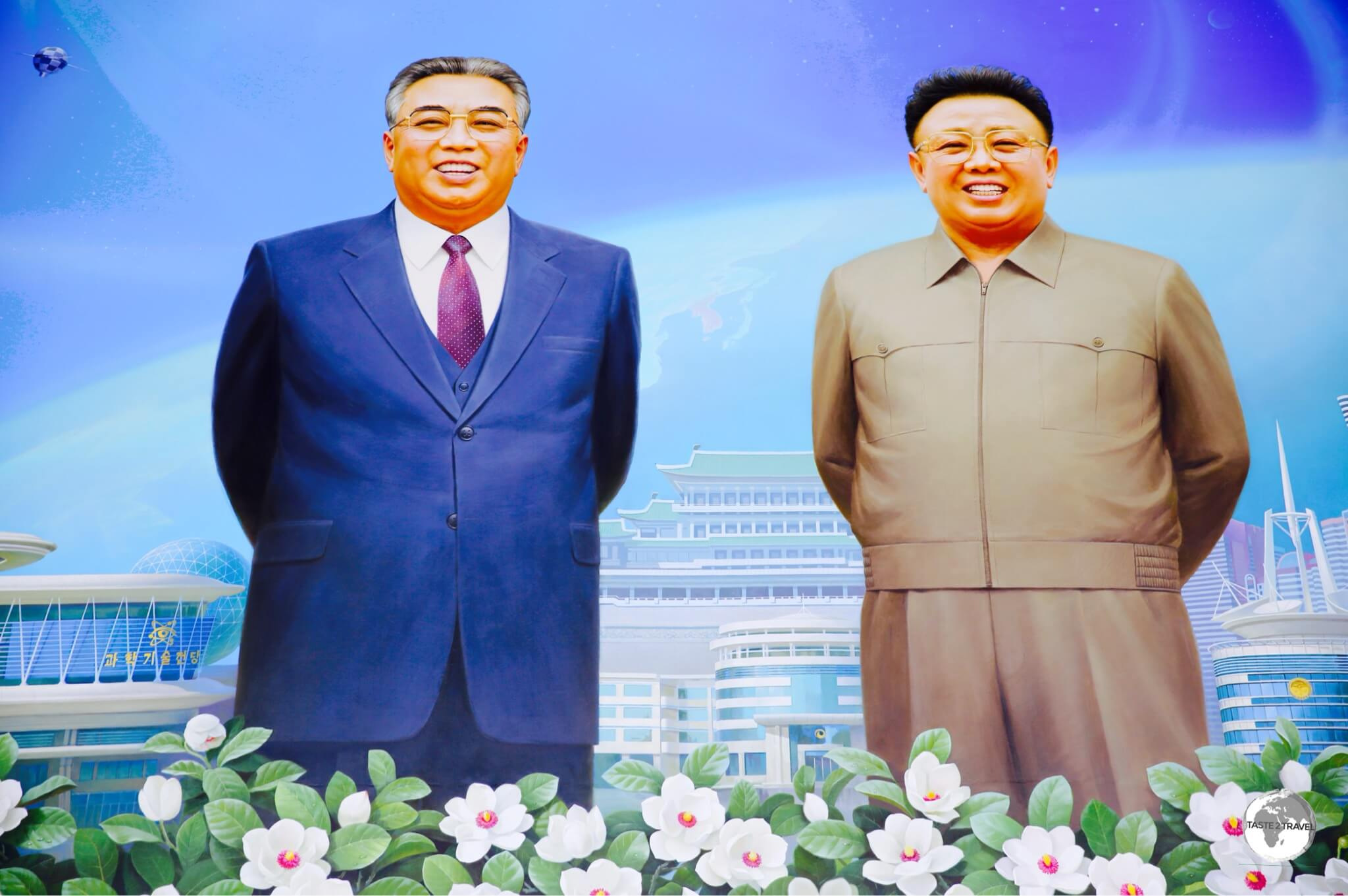 An idealised portrait of the DPRK leadership at the Science & Technology centre in Pyongyang.