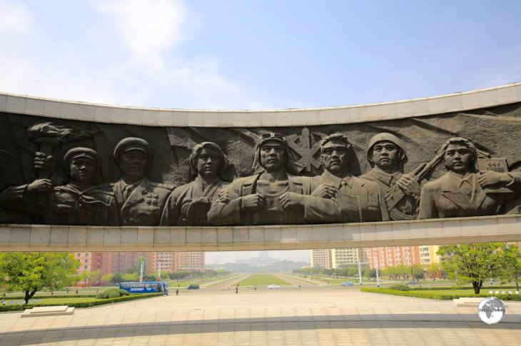 Detail of one of the large bronze panels which surround the <i>Monument to Party Founding</i> in Pyongyang.