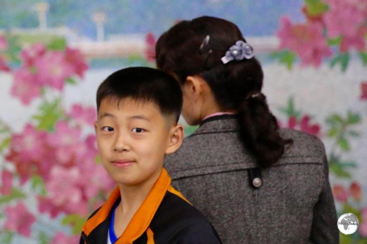 A boy waiting for his train at Yonggwang metro station.