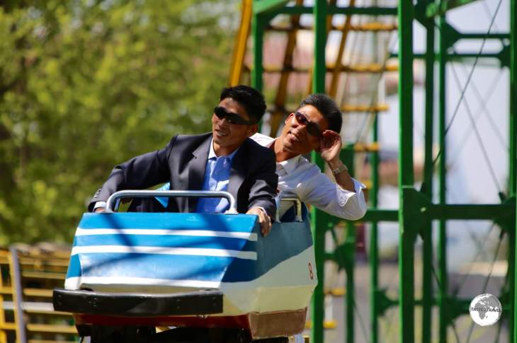 North Koreans enjoying a free roller coaster ride at Taesongsan Fun Fair.