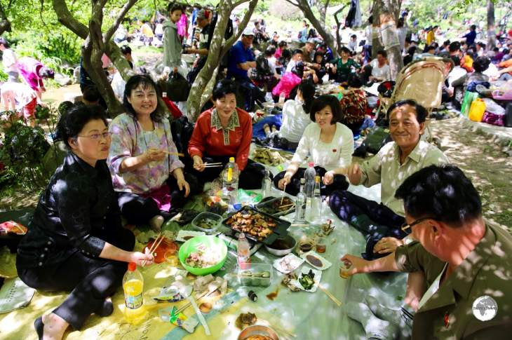 A group of friendly and welcoming North Koreans, enjoying a picnic lunch at Moran hill during the May day public holiday.