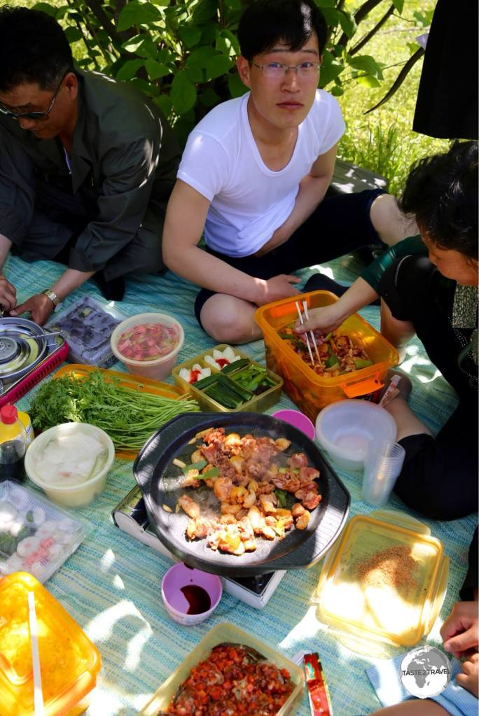 North Koreans enjoy a May Day picnic on Moran Hill. Picnics are a popular pastime in North Korea with plenty of food and Soju (rice wine) consumed.