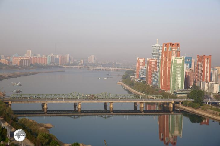 Morning view of the Taedong river and Future Scientist street from the Yanggakdo International Hotel.