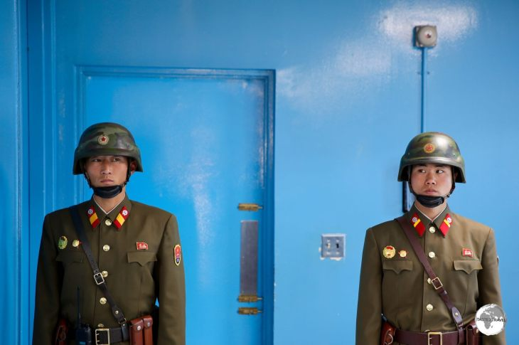 Guarded by two North Korean soldiers, the blue door is the exit to the South Korean side of the JSA.