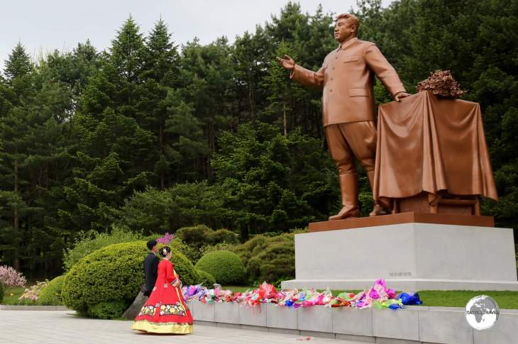 On their wedding day, all newlyweds are required to pay their respects to the 'dear leader' by laying flowers and bowing.