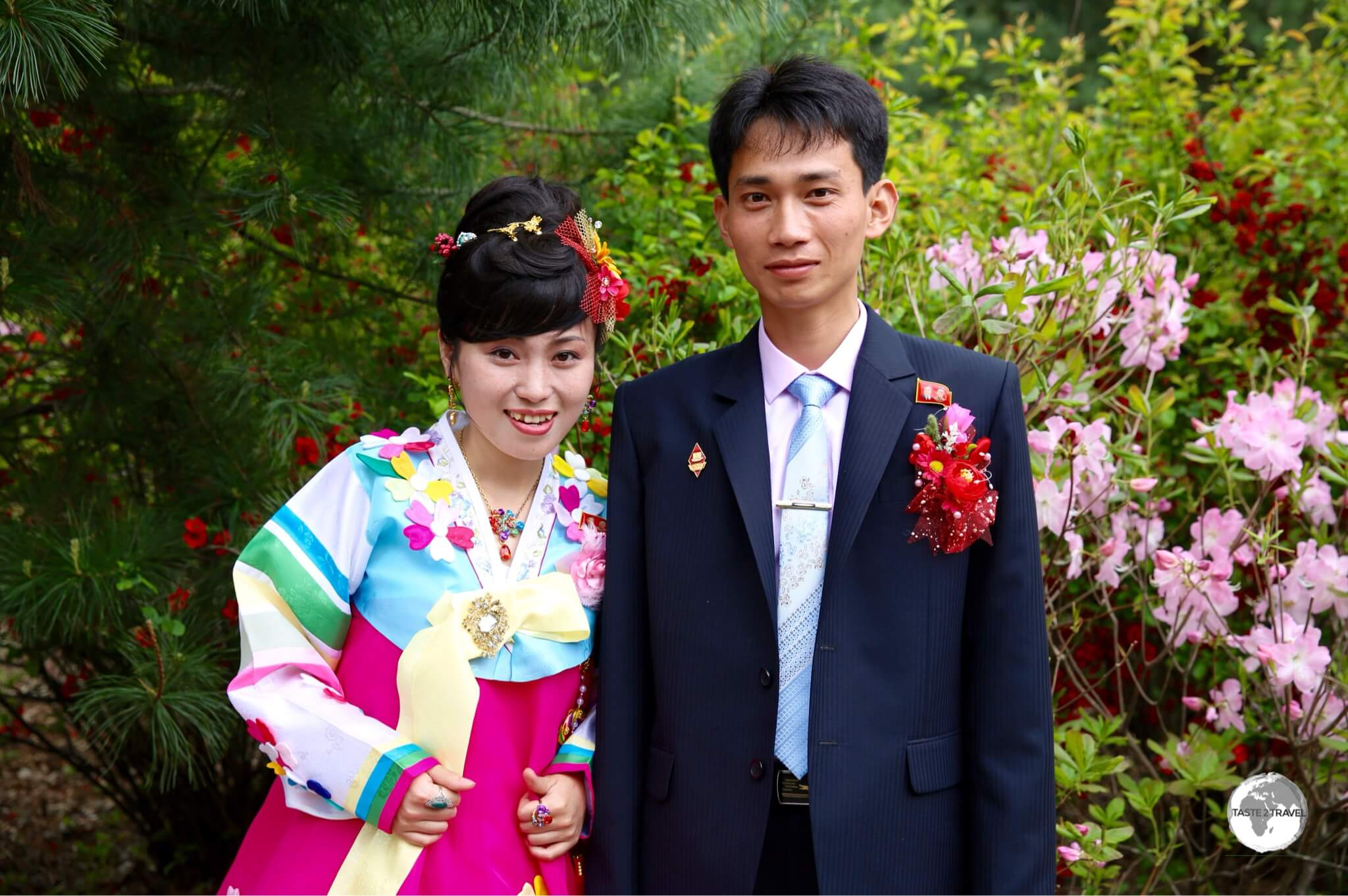 A bride and groom visiting a park near Pyongyang.