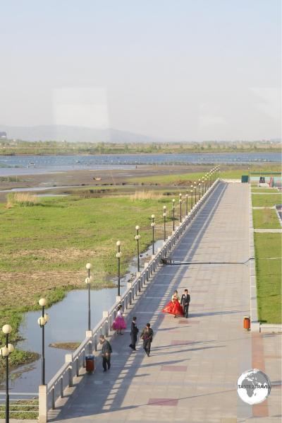 Our first view of North Korea - the spotlessly clean promenade on the banks of the Yalu river - opposite Dandong, China.