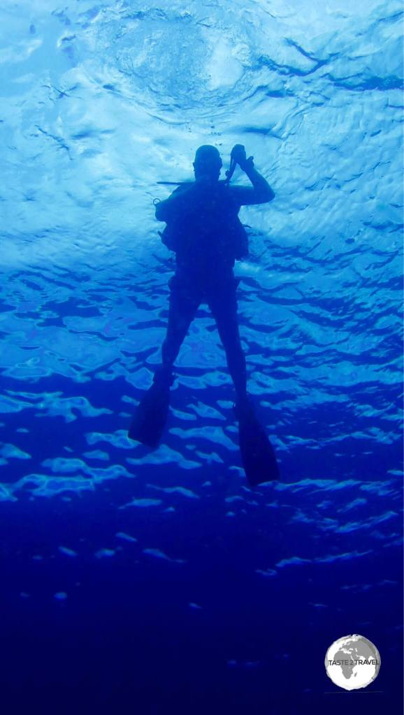 Me descending into the turquoise waters of El Nido Bay on my first dive for the day.