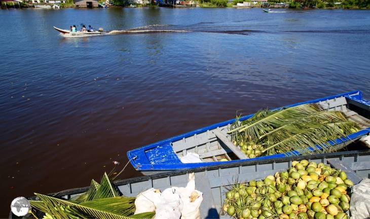 Goods from remote river communities are brought to Charity by speedboat for distribution to city market's.
