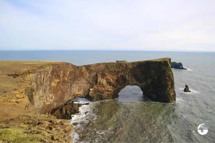 Dyrhólaey - a 120 m high arch carved out of a promontory.