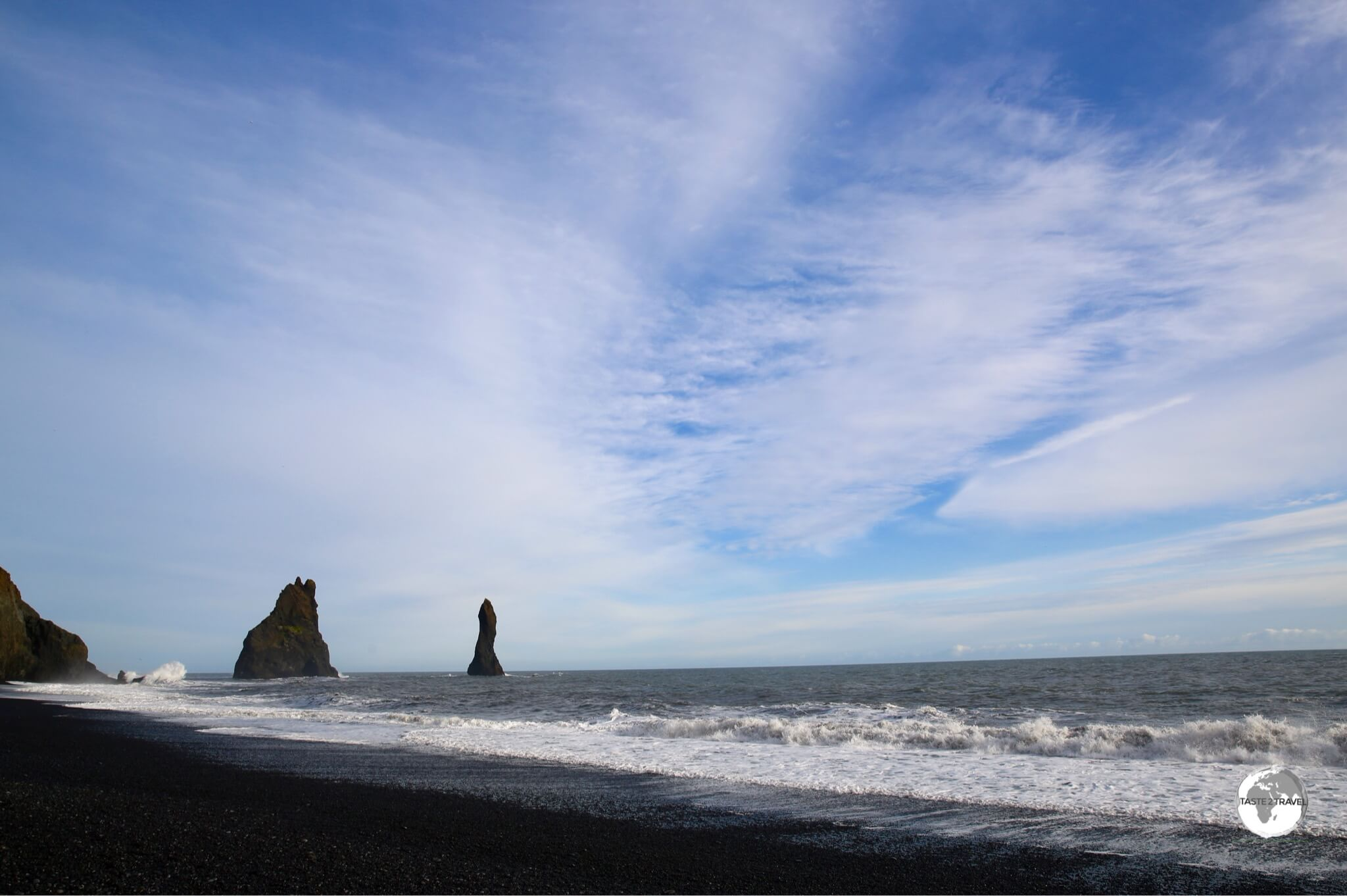 Reynisfjara (Black sand beach) with the two towering Reynisdrangar Trolls.