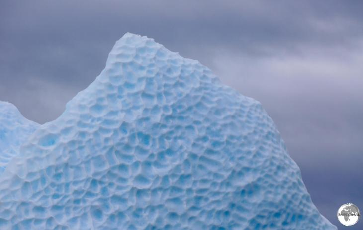The dimpled, exposed underside of a turned iceberg in Crystal Sound.