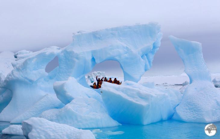 Zodiac cruising between icebergs on Crystal Sound.
