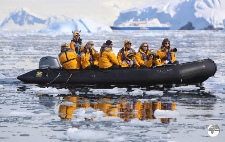 An early morning Zodiac sea excursion in the Graham passage, Antarctica.