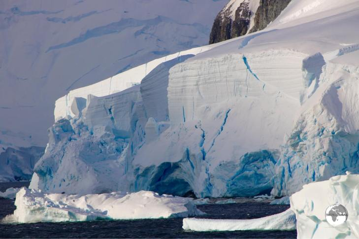 The narrow Lemaire channel is lined with gigantic glaciers and vertical granite peaks and ridges.