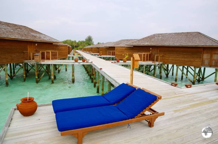 The 'Jacuzzi Water Villas' at Vilamendhoo Resort are accessed via an over-the-water boardwalk.