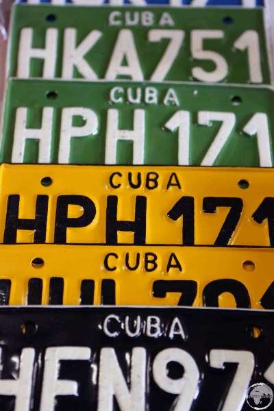 Old Cuban License plates make for popular souvenirs.