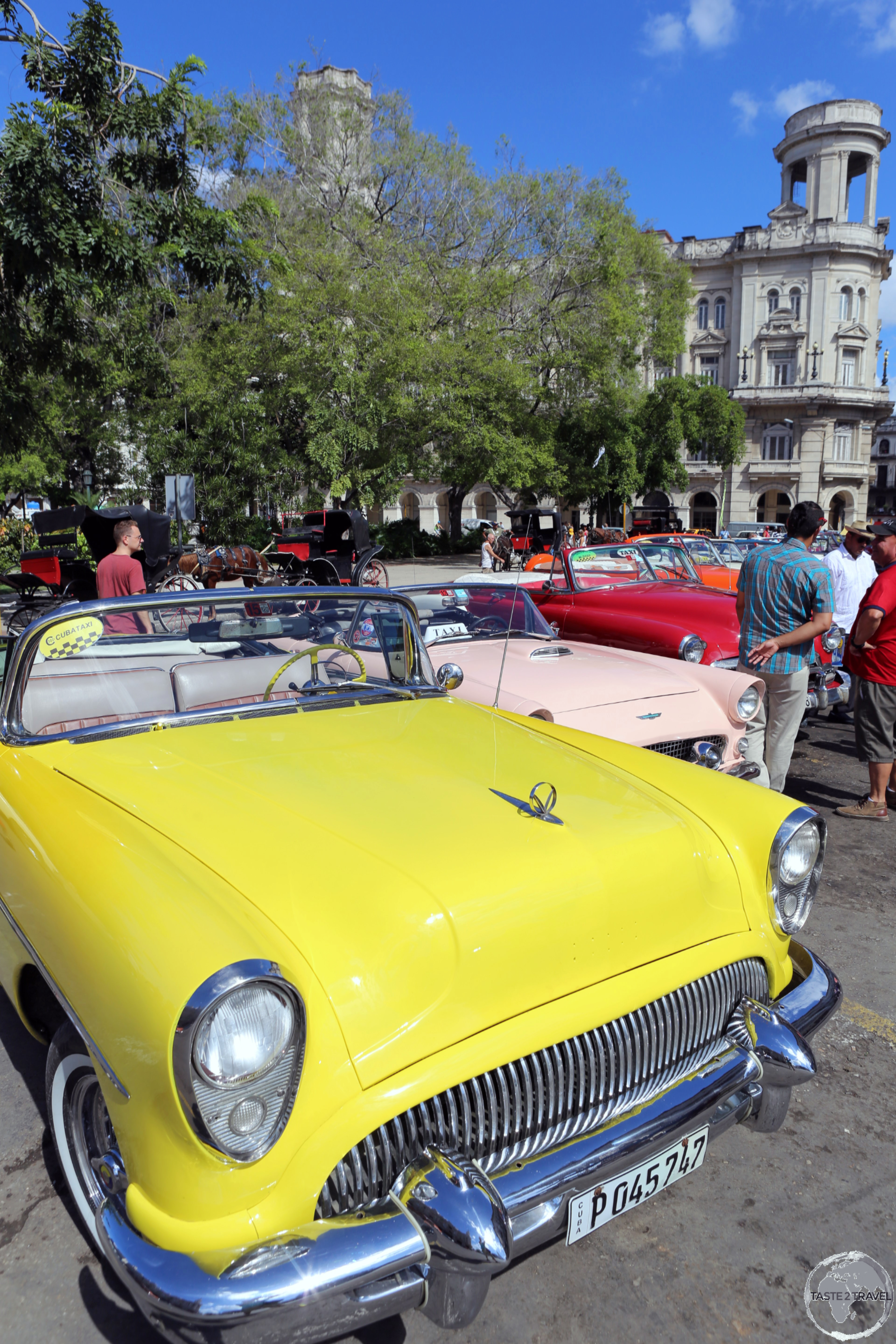 American classic car taxi's available for hire at Central Park.