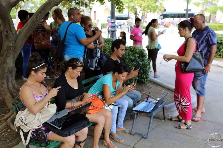 Internet surfing at Plaza José Martí in downtown Cienfuegos.