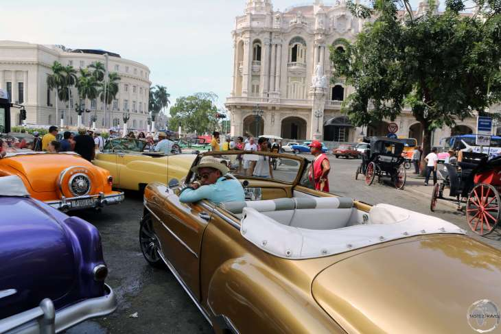 Pick your colour! American classic car taxi's available for hire at Parque Central in Havana old town.