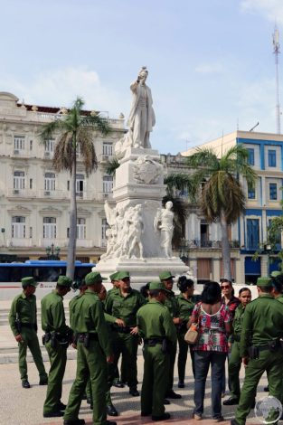 Soldiers visiting a statue of José Martí in Havana.