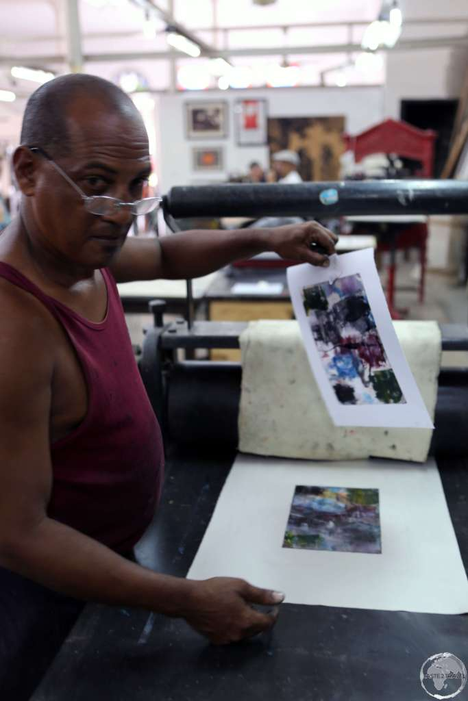 An artist working in the 'Taller Experimental de Grafica' near the Plaza de Catedral, Havana.