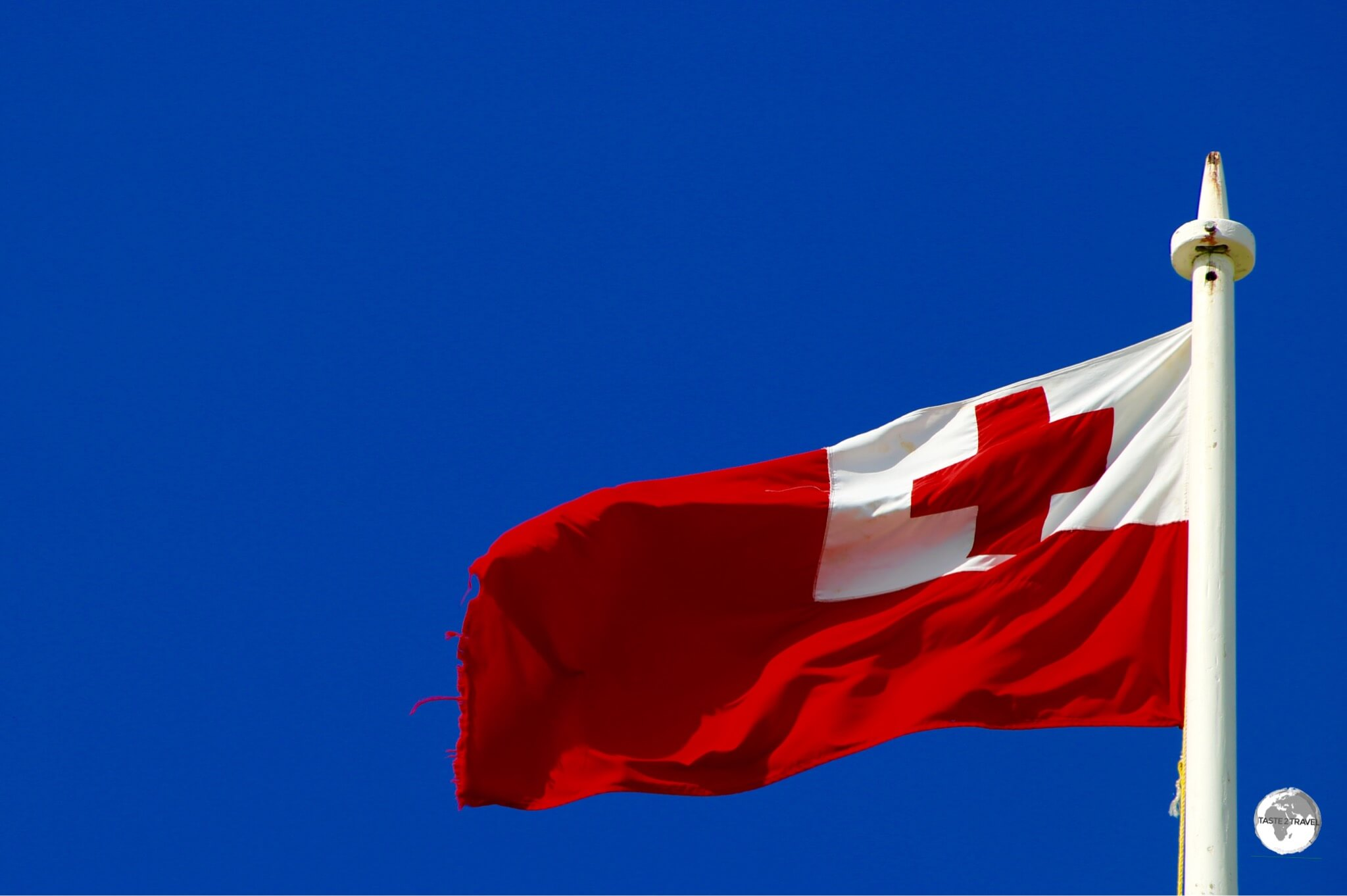 The flag of Tonga - The colours of the flag have religious meaning - The red cross alludes to Christianity while the white represents purity and the red background evokes the sacrifice of the Blood of Christ.