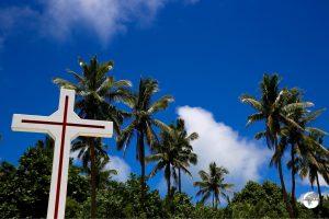 A cross among the palm trees on Pangaimotu island.