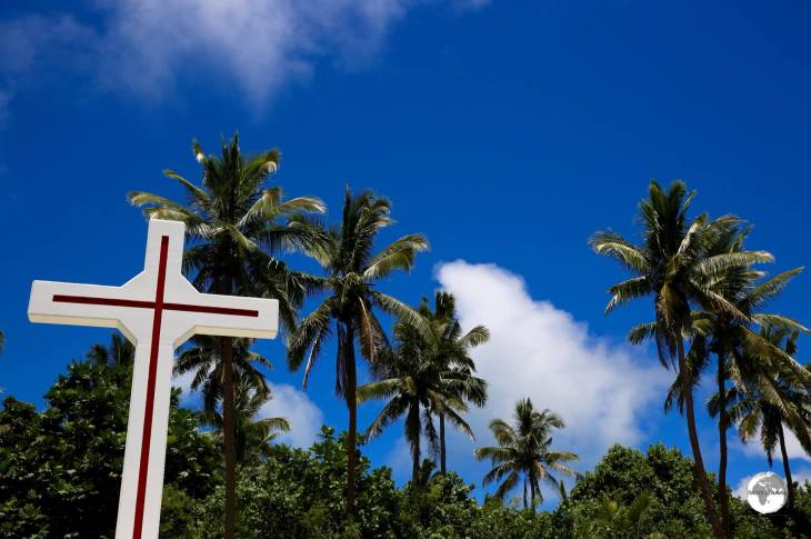 A cross among the palm trees on Pangaimotu Island.