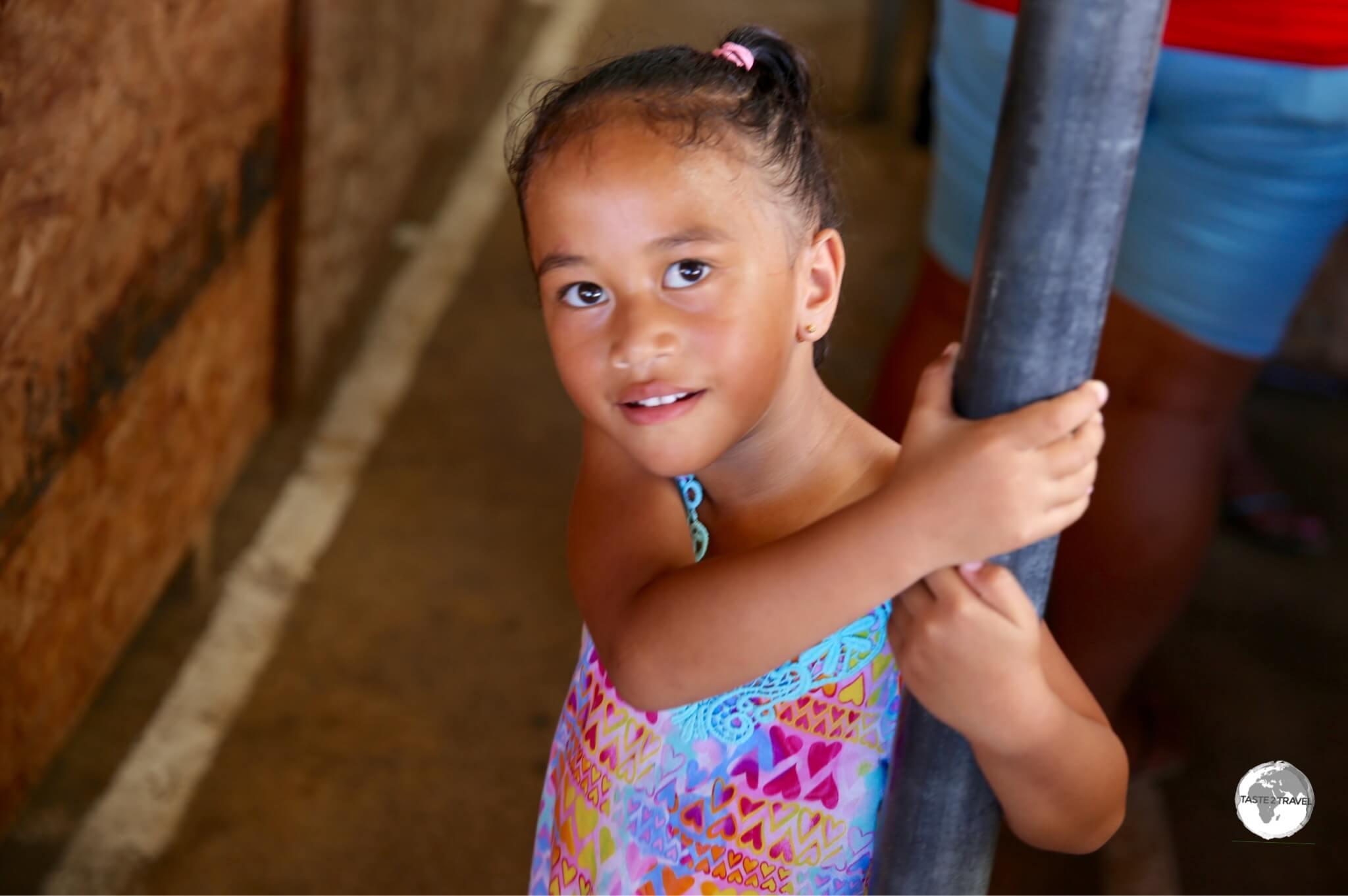 The daughter of a vendor at Talamahu market.