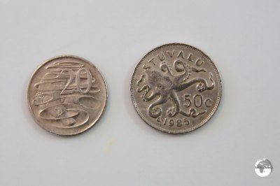 The Tuvalu 50 cent and Australian 20 cent coins are obviously different sizes in this enlarged photo but when held in your hand they are very similar.