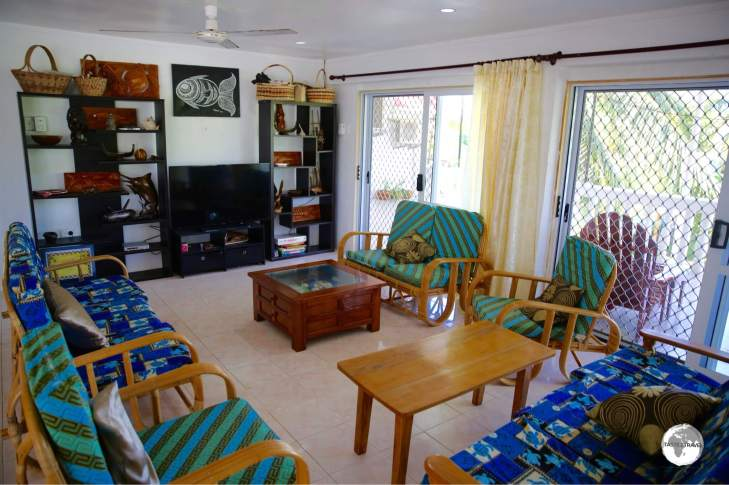 The comfortable living room at L's Lodge which includes satellite TV.